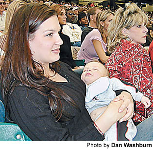 Heidi McClure, wife of Atlanta Falcons center Todd McClure, holds son Maverick during the Falcons 28-10 loss to New Orleans last Sunday at the Georgia Dome. Heidi is one of few Falcons fans who watches the offensive line on every play. I watch him to see if he gets his guy, Heidi said. And every time he goes down, Im watching to make sure that he gets up.