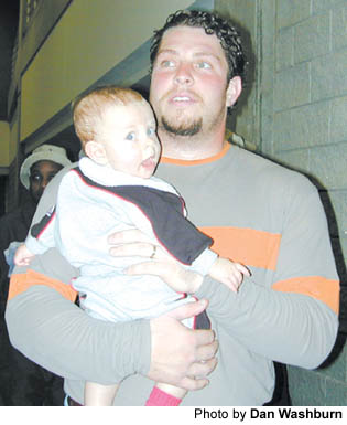 "Atlanta Falcons center Todd McClure holds his son Maverick after last week's 28-10 loss to New Orleans at the Goergia Dome. ""(Seeing Maverick) helps you get your mind off of stuff,"" Todd said. ""Until we go in and watch film tomorrow."""
